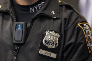 A police body camera is seen on officer during news conference on pilot program involving 60 NYPD officers dubbed 'Big Brother' at NYPD police academy in the Queens borough of New York